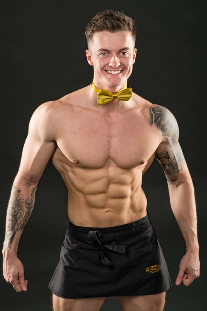 A buff butler posing for photos