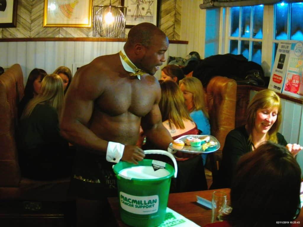 Buff butlers at a ladies night charity event in London