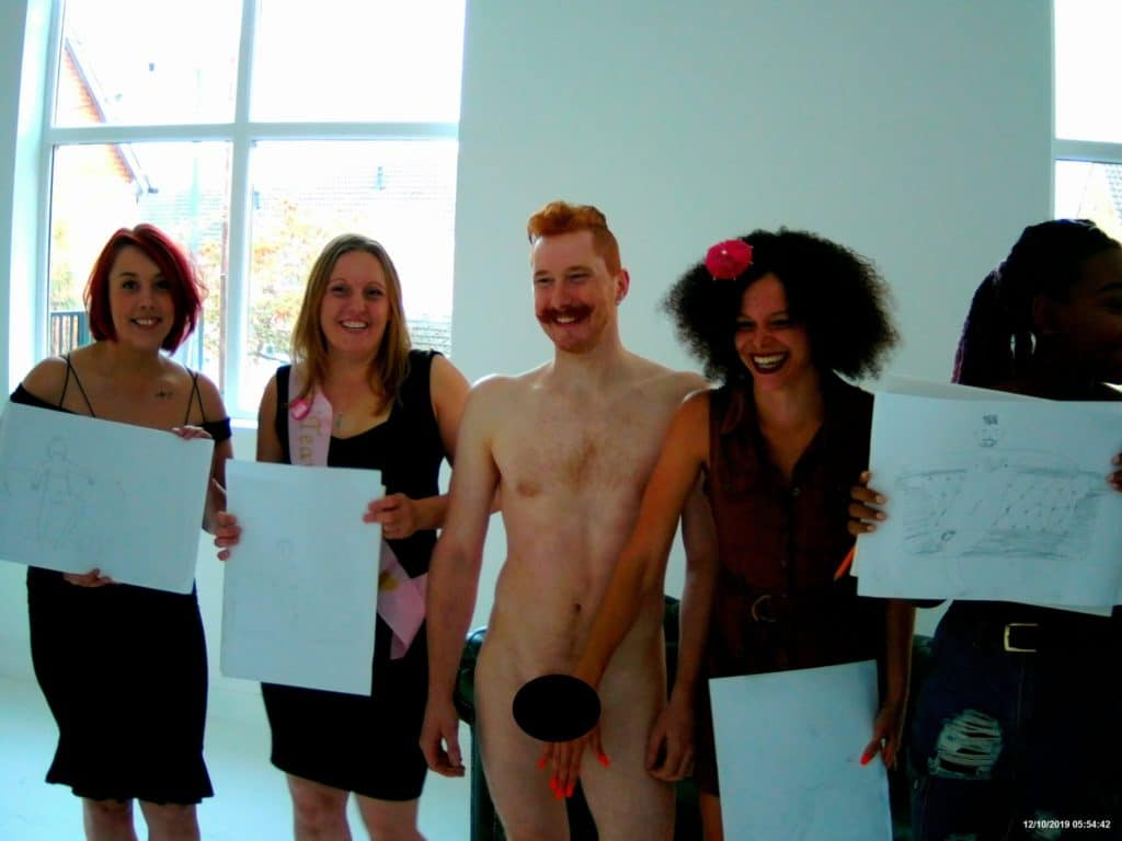 A hen party life drawing class with a hen party life model