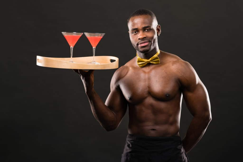 topless waiter serving cocktails at a party